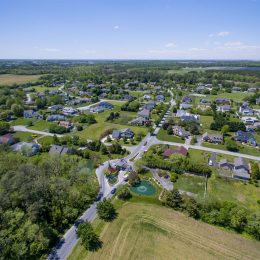 aerial of housing area with trees and grass