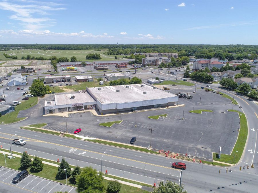 aerial of commercial property with parking lot